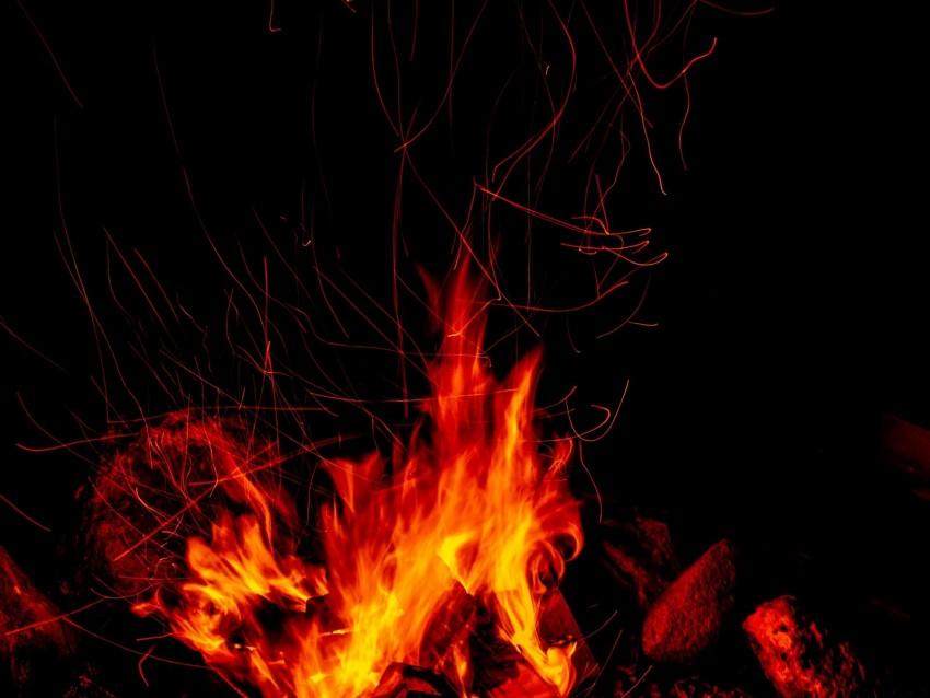free PNG bonfire, fire, sparks, flame, dark background PNG images transparent
