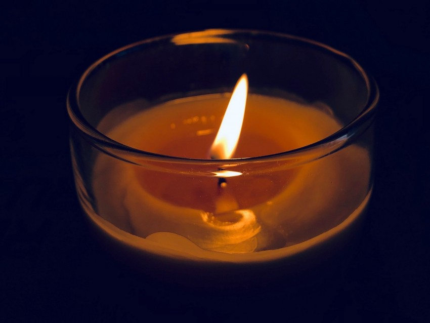 free PNG candle, glass, fire, wick, burn, dark background PNG images transparent