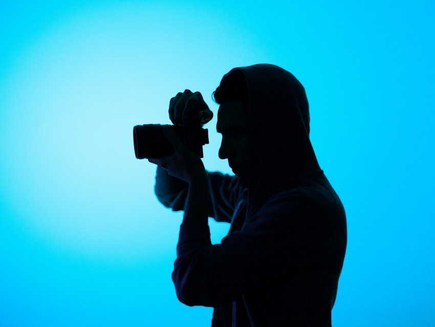 free PNG photographer, hood, camera, dark, shooting, blue background PNG images transparent